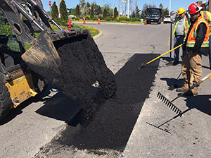 Laying down asphalt