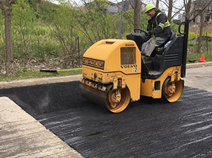 Asphalt being compacted