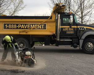 High Speed Saw cutting out pavement