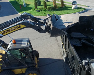 Discarded asphalt is recycled and put into the dump truck